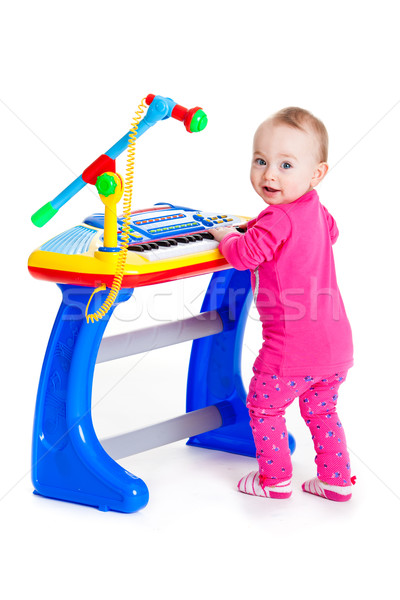 little girl and the keyboard on white background. funny girl. young DJ Stock photo © EwaStudio