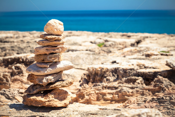 Stock photo: Stones balance, pebbles stack over blue sea