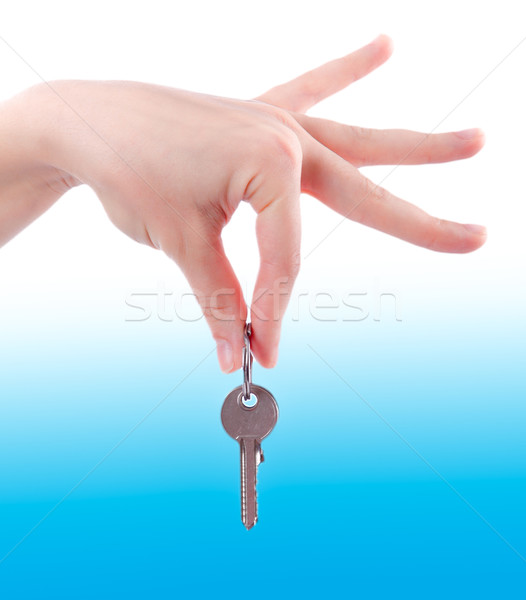 Silver key in a hand.  Hand holding key Stock photo © EwaStudio