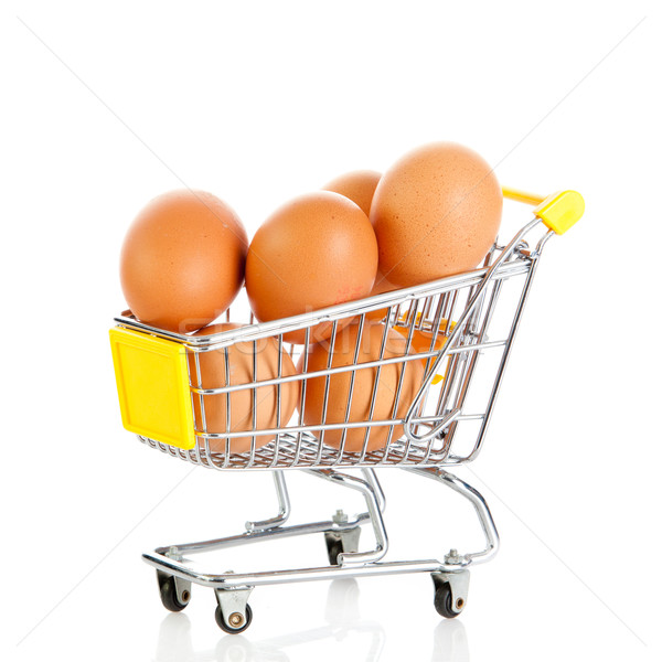 Eggs in the shopping cart isolaten in white. Brown eggs in the b Stock photo © EwaStudio