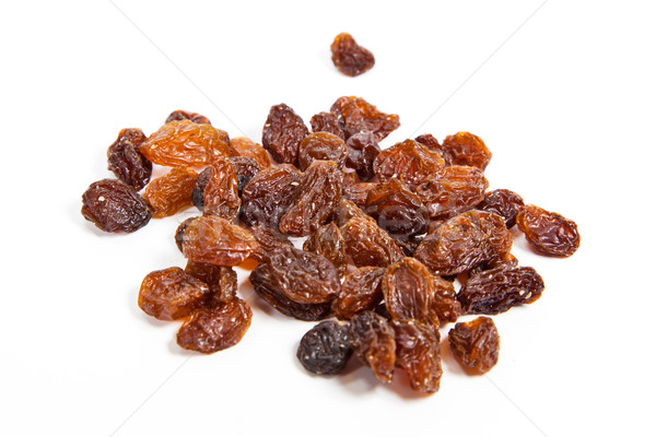 brown raisins on a white background  Stock photo © EwaStudio