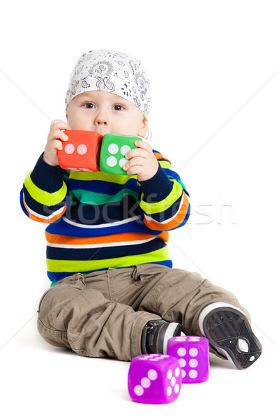 Stock photo: baby is playing with  toys over white background. Funny little k