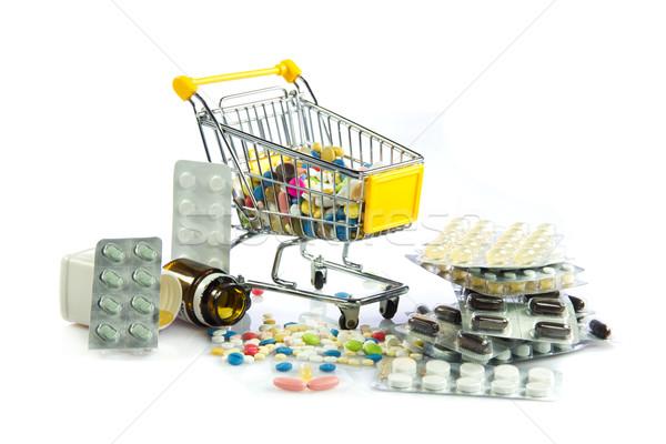 shopping cart full of pills isolated on white. Shopping cart wit Stock photo © EwaStudio