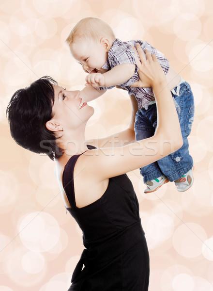 Beautiful happy mother with attractive baby  Stock photo © EwaStudio