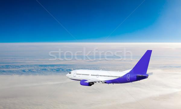 Avião voar céu nuvens negócio pôr do sol Foto stock © EwaStudio