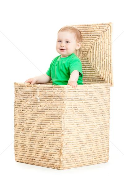 Stock photo: little boy inside a box on a white background