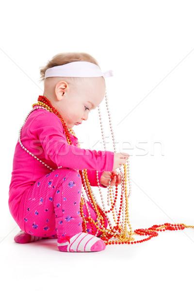 Kislány játszik gyöngyök gyönyörű boldog baba Stock fotó © EwaStudio
