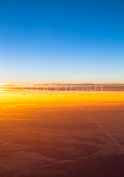 Dramatic sunset.  View of sunset above clouds from airplane wind Stock photo © EwaStudio