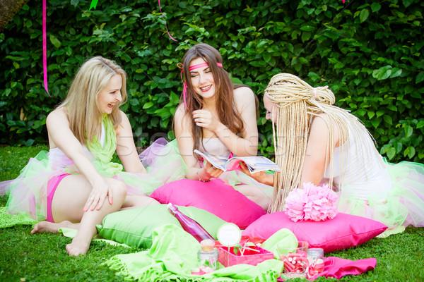 group of beautiful female friends smiling Stock photo © EwaStudio