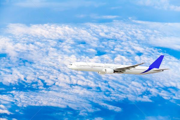 Vliegtuig vliegen hemel wolken business zonsondergang Stockfoto © EwaStudio
