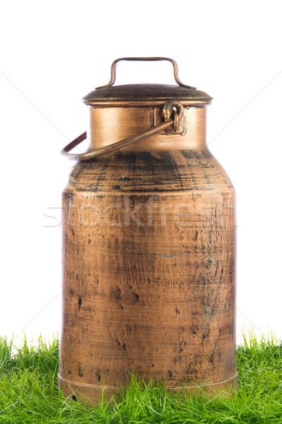 Retro milk can. old can of milk on white background Stock photo © EwaStudio