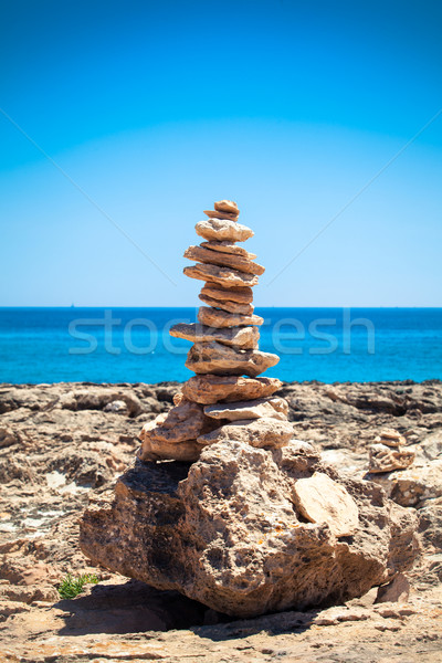 Stock photo: Stones balance, pebbles stack over blue sea