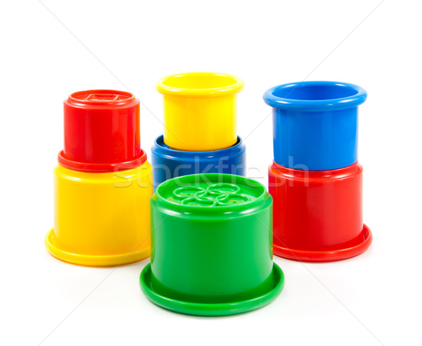 Stock photo: Colorful toys for kids. plastic cups on the white background