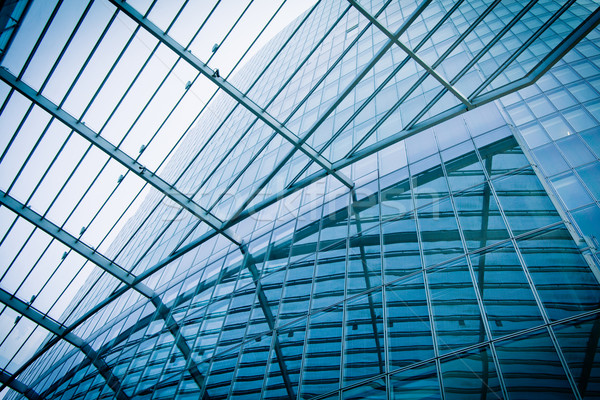 Modern üveg sziluettek felhőkarcolók üzlet épület Stock fotó © EwaStudio
