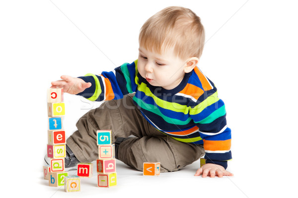 baby playing with wooden toy cubes with letters. Wooden alphabet Stock photo © EwaStudio