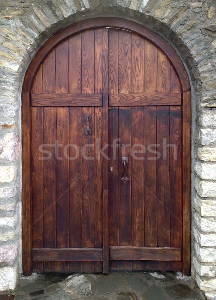 Edad puerta muro de piedra casa fondo Foto stock © exile7