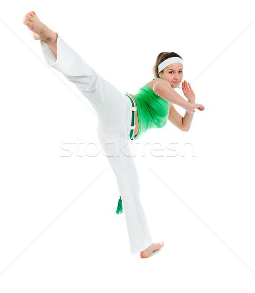 Lány capoeira táncos pózol fehér képzés Stock fotó © fanfo