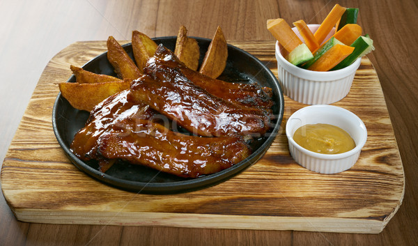 Grelhado carne de porco costelas caramelo molho prato Foto stock © fanfo