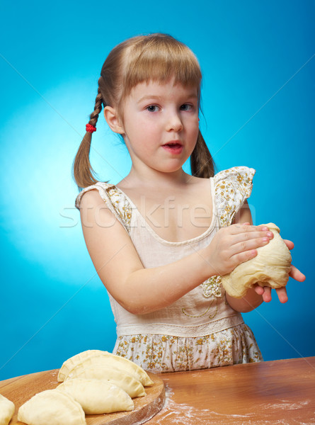 little girl kneading dough Stock photo © fanfo