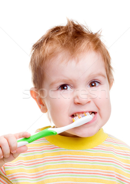 Little child with dental toothbrush brushing teeth Stock photo © fanfo