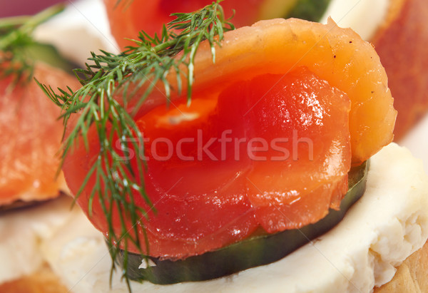 Canapes with smoked salmon  cheese and cucumber Stock photo © fanfo