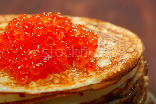 Russian pancakes  with red caviar Stock photo © fanfo