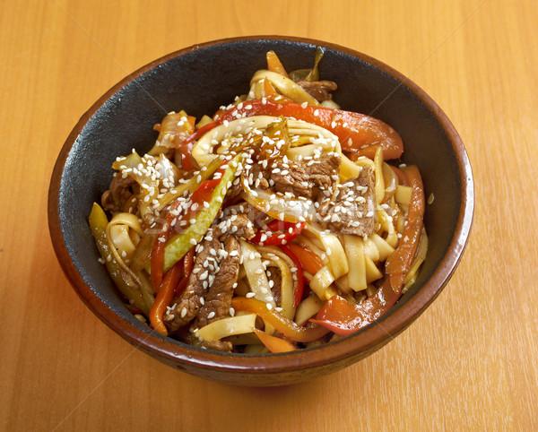 Cooking udon teppanyaki with pork  Stock photo © fanfo