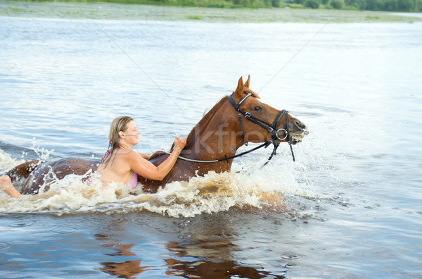 woman swimming winth  stallion in river Stock photo © fanfo