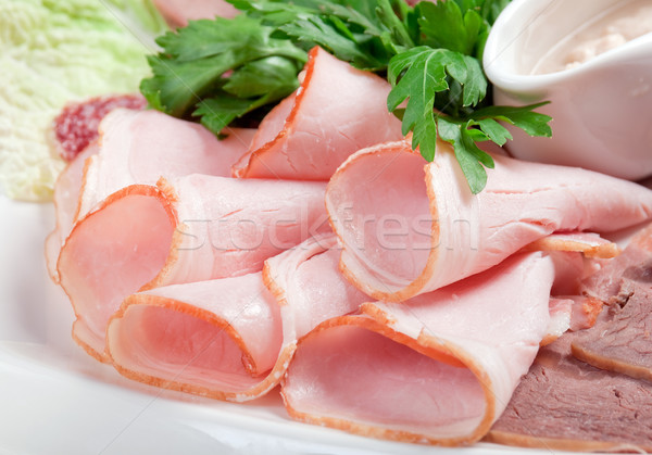 sliced food  meat and sausage arrangement . Stock photo © fanfo