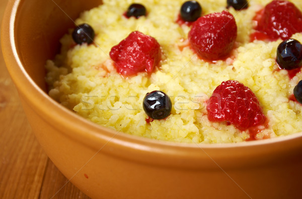Millet porridge with berry Stock photo © fanfo