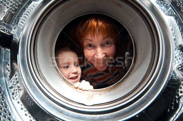 Mulher menino máquina de lavar velho olhos Foto stock © fanfo