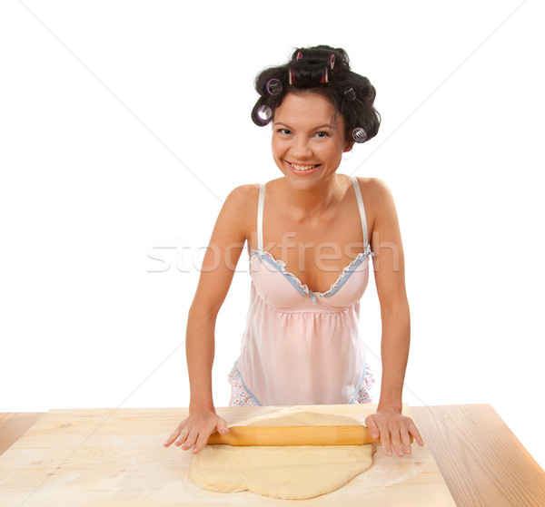 housewife mix dough on the wooden board. Stock photo © fanfo