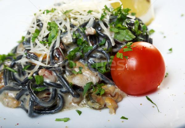 Spaghetti voedsel pasta zwarte tomaat koken Stockfoto © fanfo