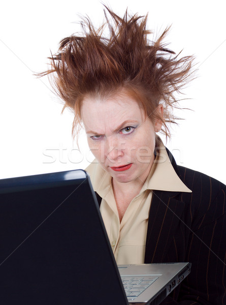 Stock photo: Angry crazy  Business woman with a laptop