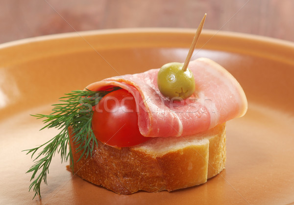 Canapes with smoked bacon Stock photo © fanfo