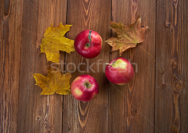 Autumn border from apples and fallen leaves  Stock photo © fanfo
