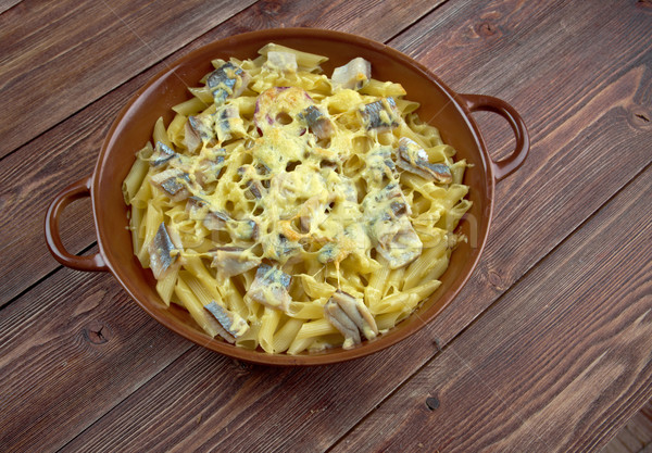 Baked pasta penne with mackerel Stock photo © fanfo