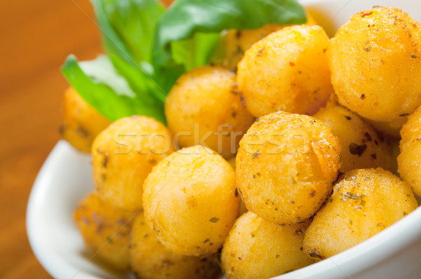 Baked potatoes wedges Stock photo © fanfo