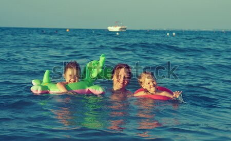 family in the waves Stock photo © fanfo