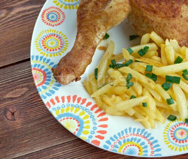 Kip met frieten Stock photo © fanfo