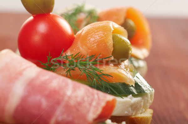 Canapes with smoked salmon ,bacon Stock photo © fanfo