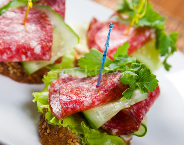 Canape with salami and Stock photo © fanfo