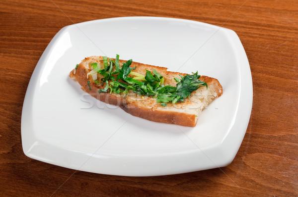 italian bruschetta seasoned with parsley and spring onions Stock photo © fanfo