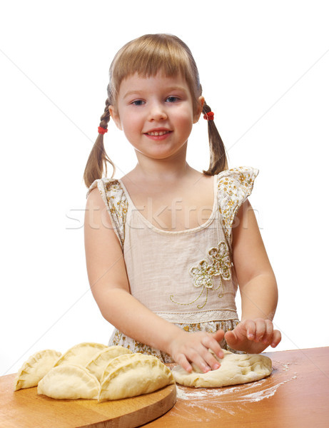 little girl kneading dough Stock photo © fanfo