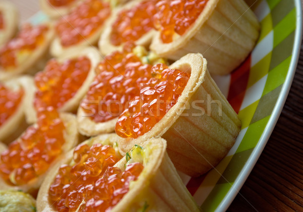 Tartlet with red caviar   . Stock photo © fanfo