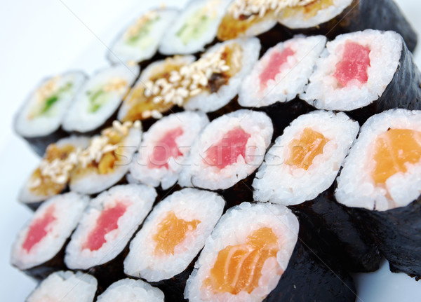 Roll made salmon, eel, tuna, vegetables Stock photo © fanfo