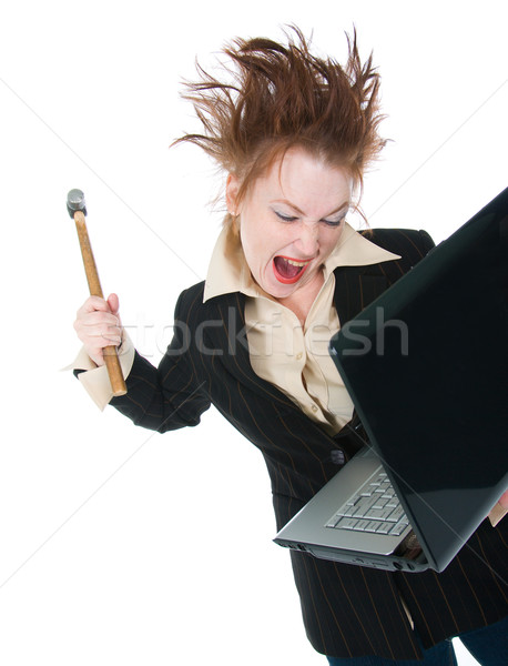 stressed businesswoman smashing her laptop with a hammer  Stock photo © fanfo