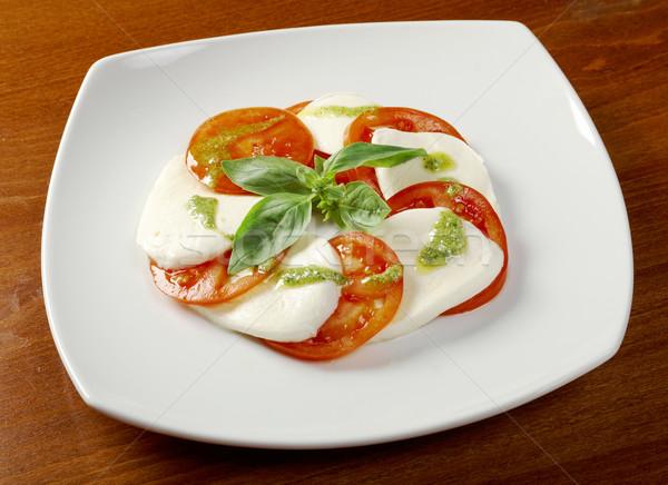 Arrangement of mozzarella and tomatoes Stock photo © fanfo