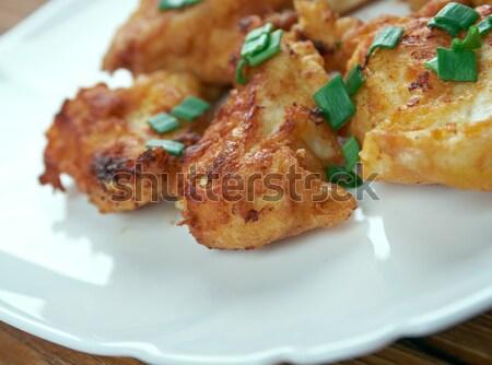 Pattogatott kukorica tyúk étel hús paradicsom forró Stock fotó © fanfo