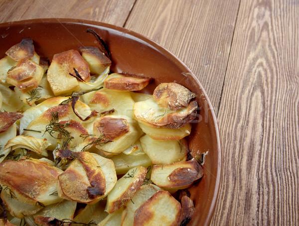 Potato and onion gratin Stock photo © fanfo